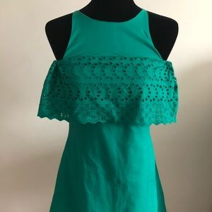 Green sleeveless dress with ruffle accents